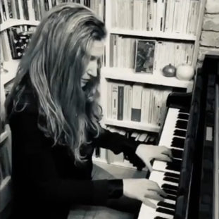 Alba playing the piano